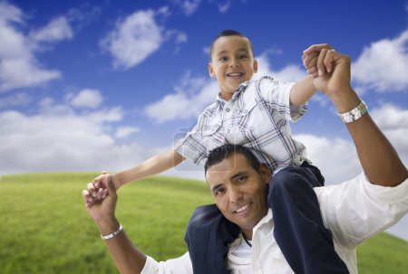 Hispanic Father and Son Having Fun Together