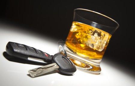 Alcoholic Drink and Car Keys Under Spot Light....