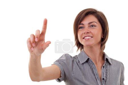 Photo pour Femme d'affaires en appuyant sur un bouton de l'écran tactile - image libre de droit