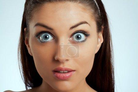 Photo for Close-up portrait of an amazed female on white background - Royalty Free Image