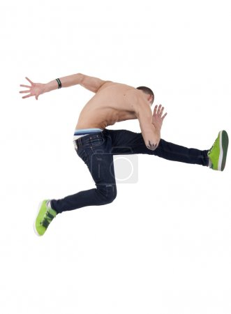 Young man posing in a very high jump dance move