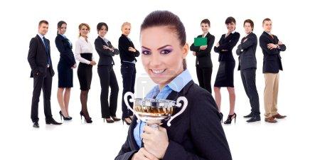 Winning businessteam, female holding trophy