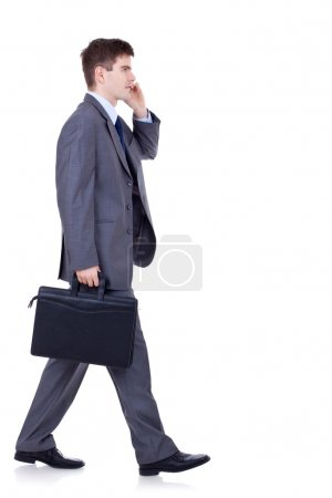 Man walking and talking on phone