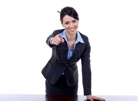 Woman standing behind a desk