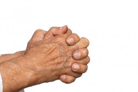 Photo pour Mains jointes d'un homme senior dans la prière - isolé sur blanc - image libre de droit