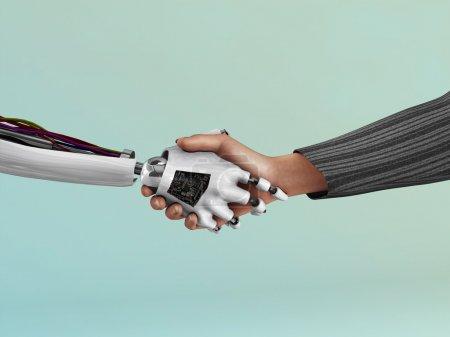 Photo pour Une image de la poignée de main entre un robot et un humain. - image libre de droit