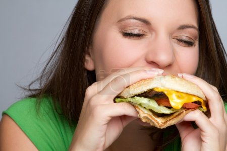 Photo for Beautiful girl eating hamburger food - Royalty Free Image