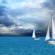 Two sail boats sailing after a storm...