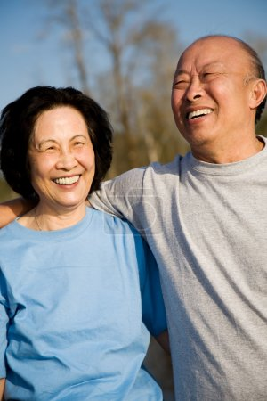 Photo for A shot of a senior asian couple having fun outdoor - Royalty Free Image