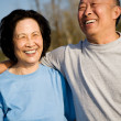 A shot of a senior asian couple having fun outdoor...