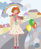 Girl with flowers and balloons in the city