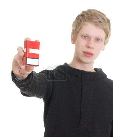 Man holding pack of cigarettes.