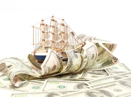 Sailing vessel on waves from dollars