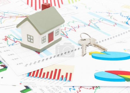 Photo for Housing market concept image with graph and toy house - Royalty Free Image