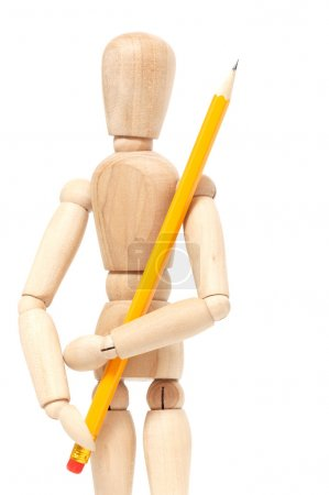 Wooden puppet holding pencil