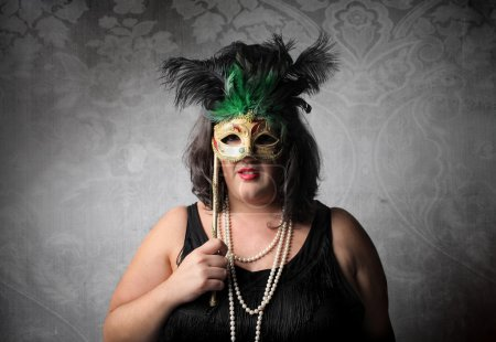 Photo for Fat woman wearing a mask - Royalty Free Image