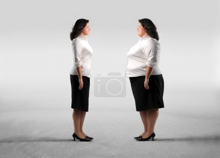Photo for Fat woman standing in front of her thinner alter ego - Royalty Free Image