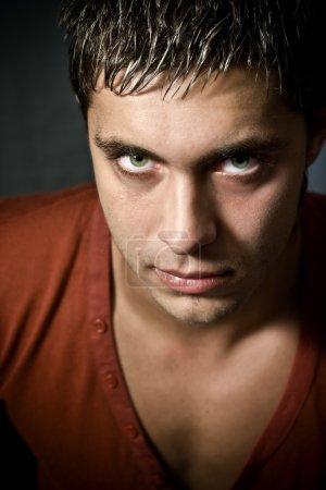 Low key portrait of intense looking guy