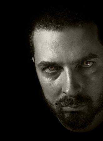 Evil man - portrait in the dark