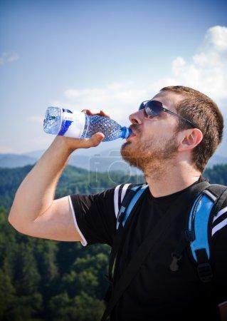 Handsome man drinking water
