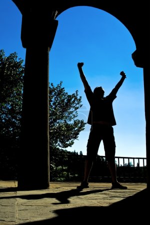 Man silhouette expressing victory