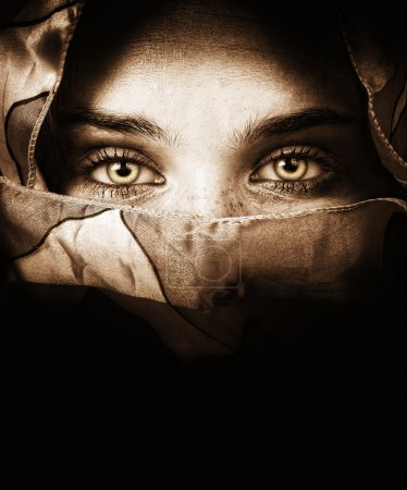 Sensual eyes of mysterious woman behind scarf...