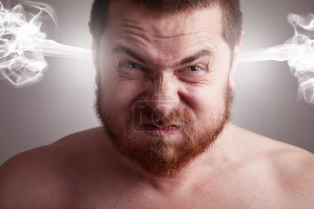 Stress concept - angry frustrated man with explodi...