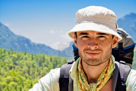 Photo for Portrait of hiker, standing against the mountains - Royalty Free Image