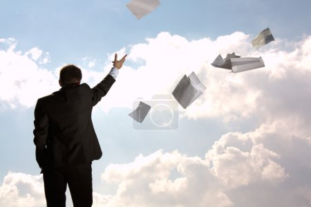 Photo for The the businessman, in a suit throws a pile of documents. - Royalty Free Image