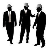 Three businessmen architects or engineers with a protective helmet walking and talking about new project Isolated white background EPS file available
