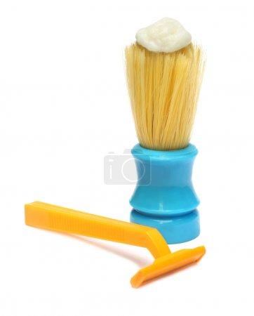 Razor and brush with shaving cream