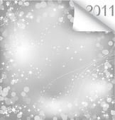 Sparkling sheet of paper with curl 2011 Vector