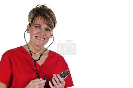 Photo pour Séduisante infirmière en uniforme avec stéthoscope - image libre de droit