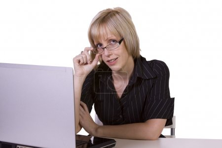 Photo for Isolated Businesswoman with spectacles working on laptop - Royalty Free Image