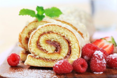 Photo for Slices of Swiss roll and fresh raspberries - Royalty Free Image