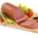 Salami sliced on a cutting board...