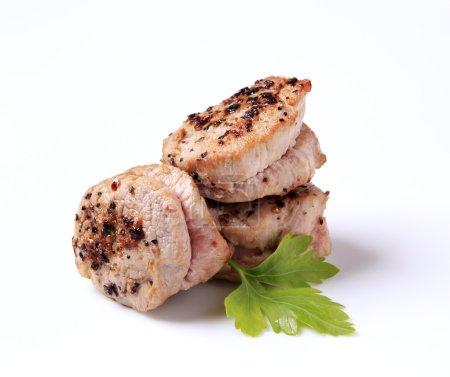 Photo for Pan roasted pork tenderloin medallions seasoned on top - Royalty Free Image