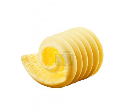 Curl of fresh butter isolated on white...