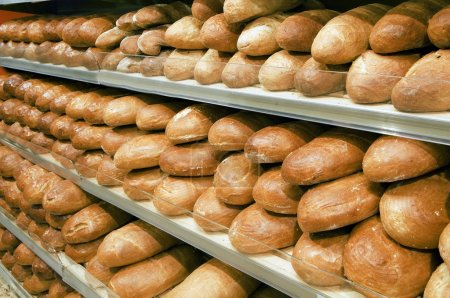Photo for Loaves of bread on shelves in a store - Royalty Free Image