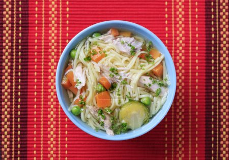 Photo for Bowl of chicken soup with noodles and vegetable - Royalty Free Image