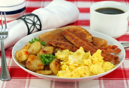 Photo for Eggs, home fries, bacon and toast for breakfast. - Royalty Free Image