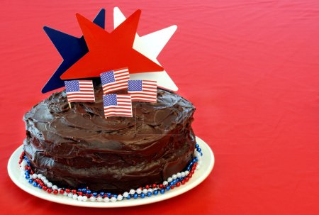 Chocolate cake with stars, flags and beads