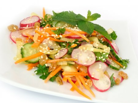 Photo for A salad of carrot, radish, cucumber, raisins, sesame and herbs - Royalty Free Image