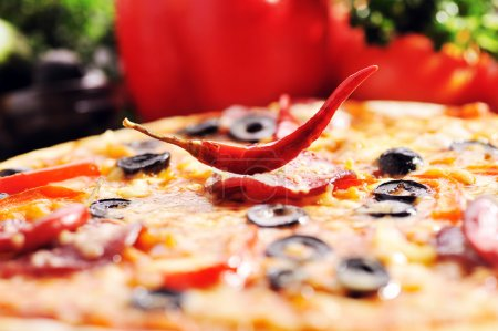 Photo for Fresh baked pizza with diferent ingredients - Royalty Free Image