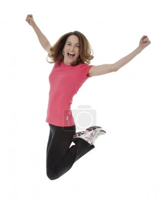 Photo for Full length studio photo of attractive woman jumping in air with arms extended. White background. - Royalty Free Image