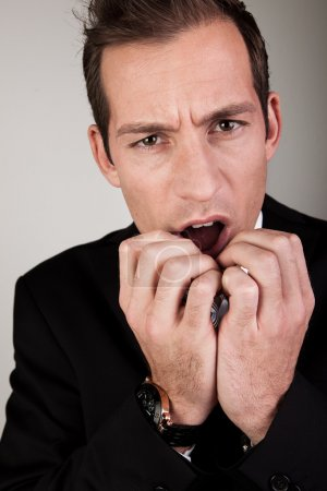 Stressed Businessman Biting His Nails