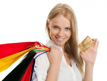 Foto de Beautilful joven llevando bolsas de compras. aislado en blanco - Imagen libre de derechos