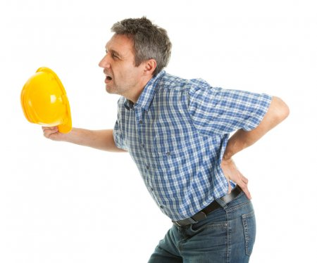 Photo for Worker suffering from pain in the back. Isolated on white - Royalty Free Image