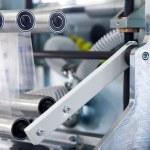 Details of a packaging machine for rolls, serviett...
