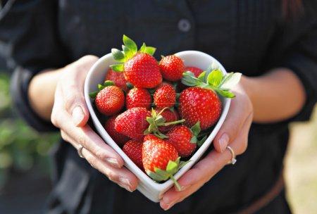 Strawberries in heart shape bowl